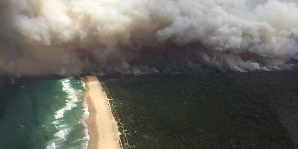 Mid-north Coast NSW, a bushfire front meets the ocean